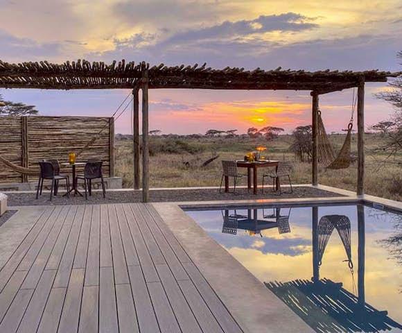 Sun sets over the pool at Namiri Plains, Serengeti